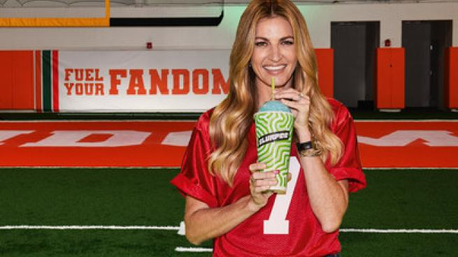 Erin Andrews standing next to a football ball